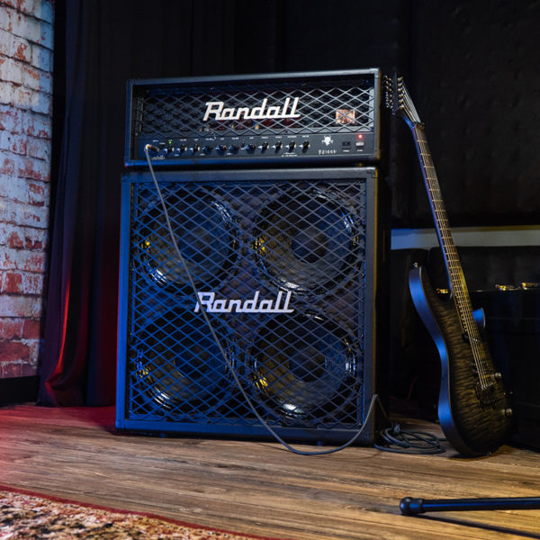 black Randall amplifier beside electric guitar