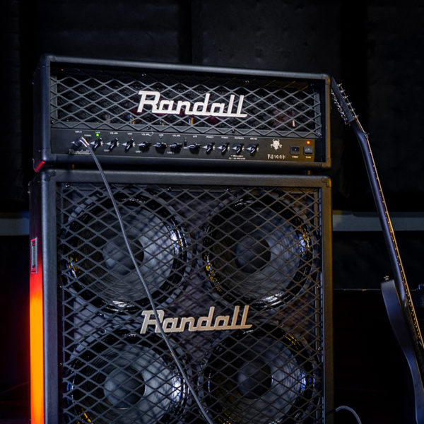electric guitar leaning on Randall amplifier with amplifier head