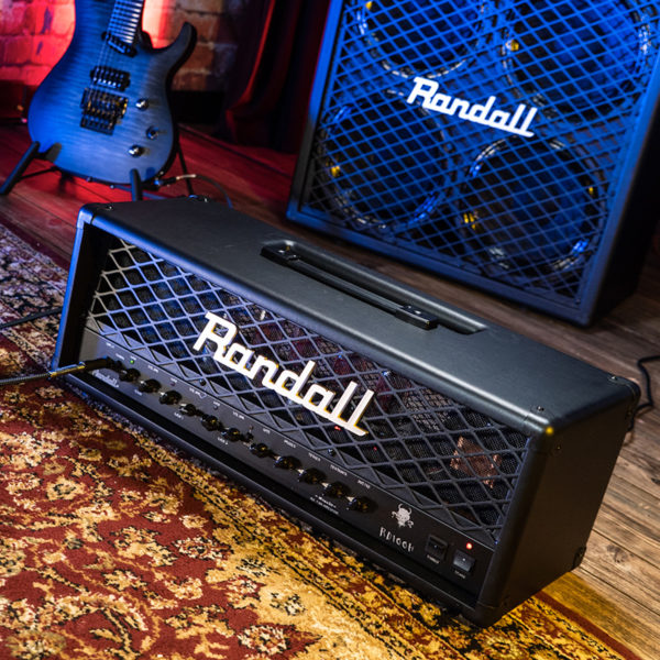 Randall amplifier head on floor in front of amplifier and electric guitar
